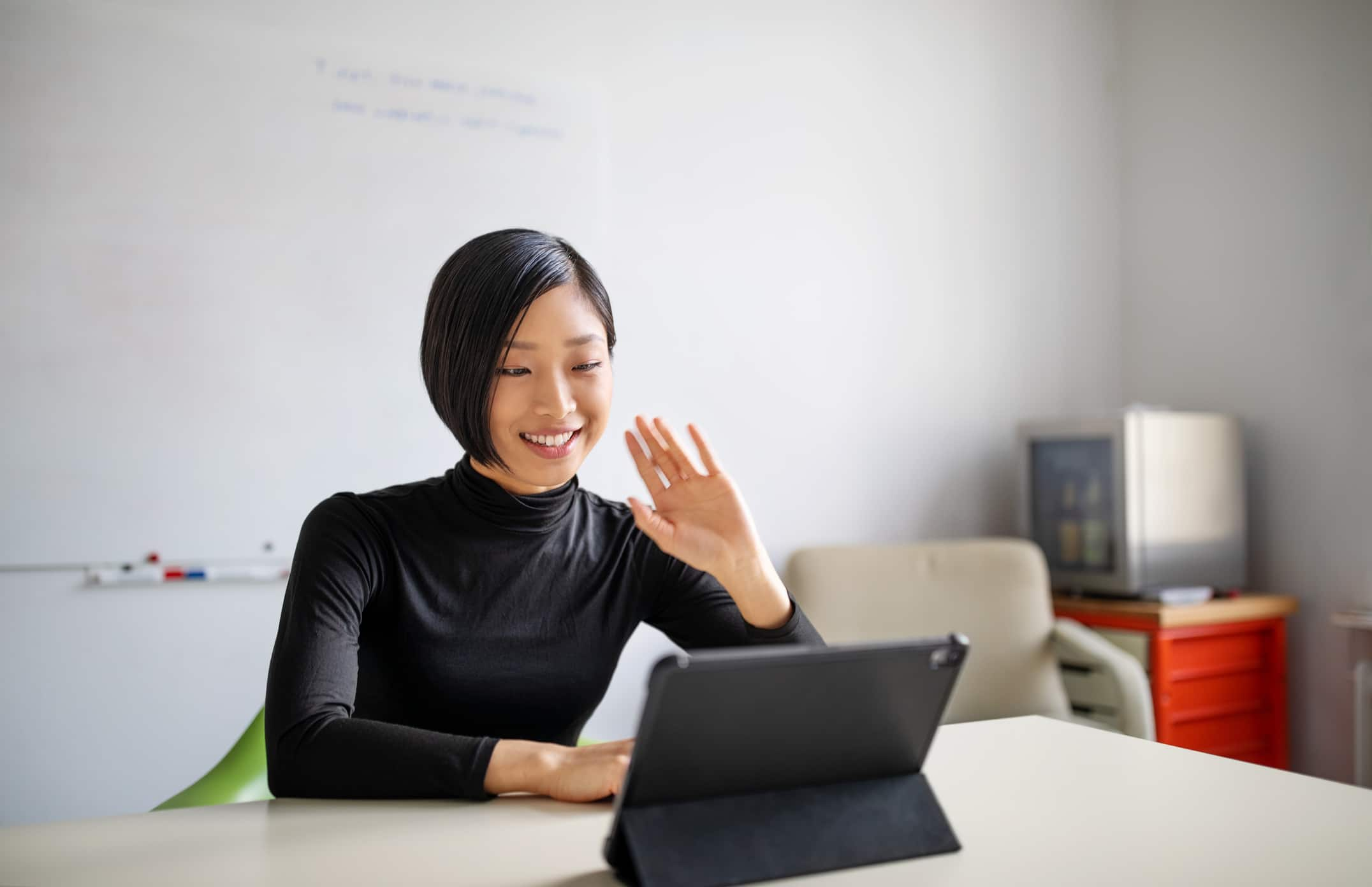 Female professional making a video call in office